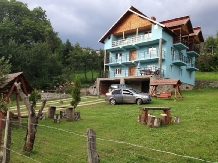 Rural accommodation at  Pensiunea La Valucu